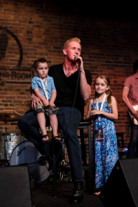 "Devin McGlamery performs ""While I Still Can,"" with a little help from his children, Preston (L) and Karlyn (R) during the release concert for Love Is A Verb, at The Listening Room Café in Nashville, TN  // Photo: Joshua Clark Photography"