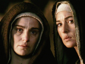 "The movie ""The Passion of the Christ"", directed by Mel Gibson.   Seen here from left, Maia Morgenstern as Mary and Monica Bellucci as Magdalen.  Initial theatrical release February 25, 2004.  Screen capture. © 2004 Icon Distribution, Inc. Credit: © 2004 Icon Distribution / Flickr / Courtesy Pikturz."