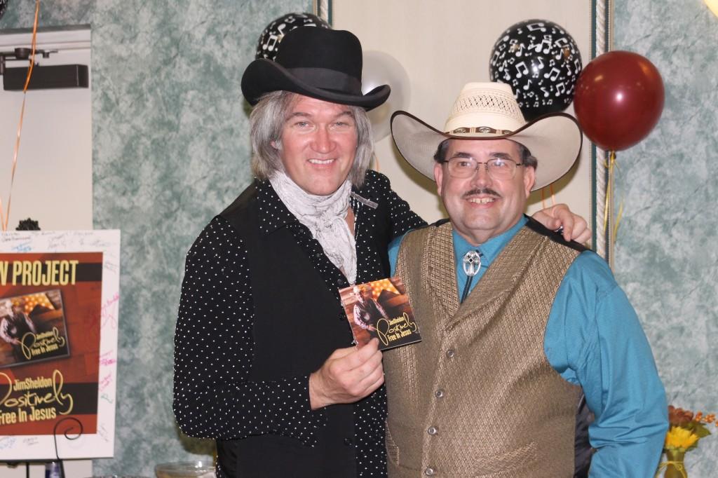 Chris Golden congratulates Jim Sheldon on his new release