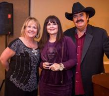Bev McCann and Lynn Fox pose with TV host Melanie Walker (center). During the USAGEM banquet, Melanie received the USAGEM Film & TV Award. As a Christian Country artist and speaker, Melanie is also known for her work with the TCT Network.