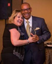 Bev McCann and Dwayne Lewis having fun. Dwayne was surprised to receive the USAGEM Non-Performing Member award during the USAGEM banquet.