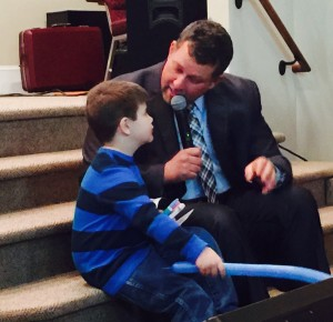 Chris Reed talking with young boy who accepted Christ.