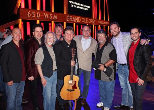 L-R: Shenandoah's Shane Chilton, Jamie Michael, Stan Munsey, Donnie Allen, Marty Raybon, Grand Ole Opry's Pete Fisher, Shenandoah's Mike McGuire, SiriusXM's J.R. Schumann, Johnstone Entertainment's Cole Johnstone